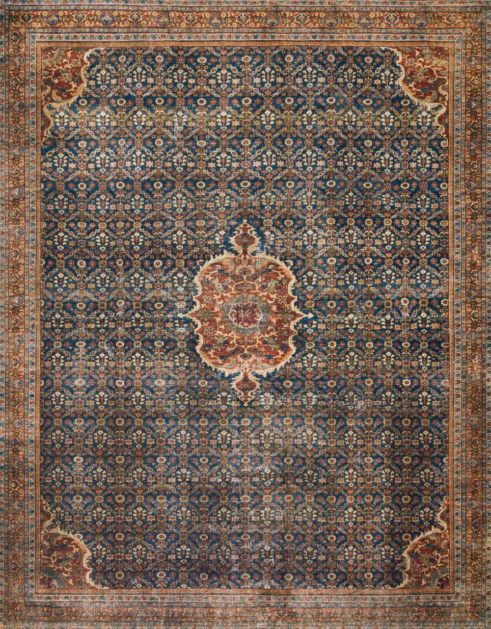The Layla Collection is traditional and timeless, with a beautiful lived-in design that captures the spirit of an old-world rug. This traditional power-loomed rug is crafted in China of 100% polyester with a classic and sophisticated color palette and subtle patina.  Power Loomed 100% Polyester LAY-09 Cobalt Blue/Spice