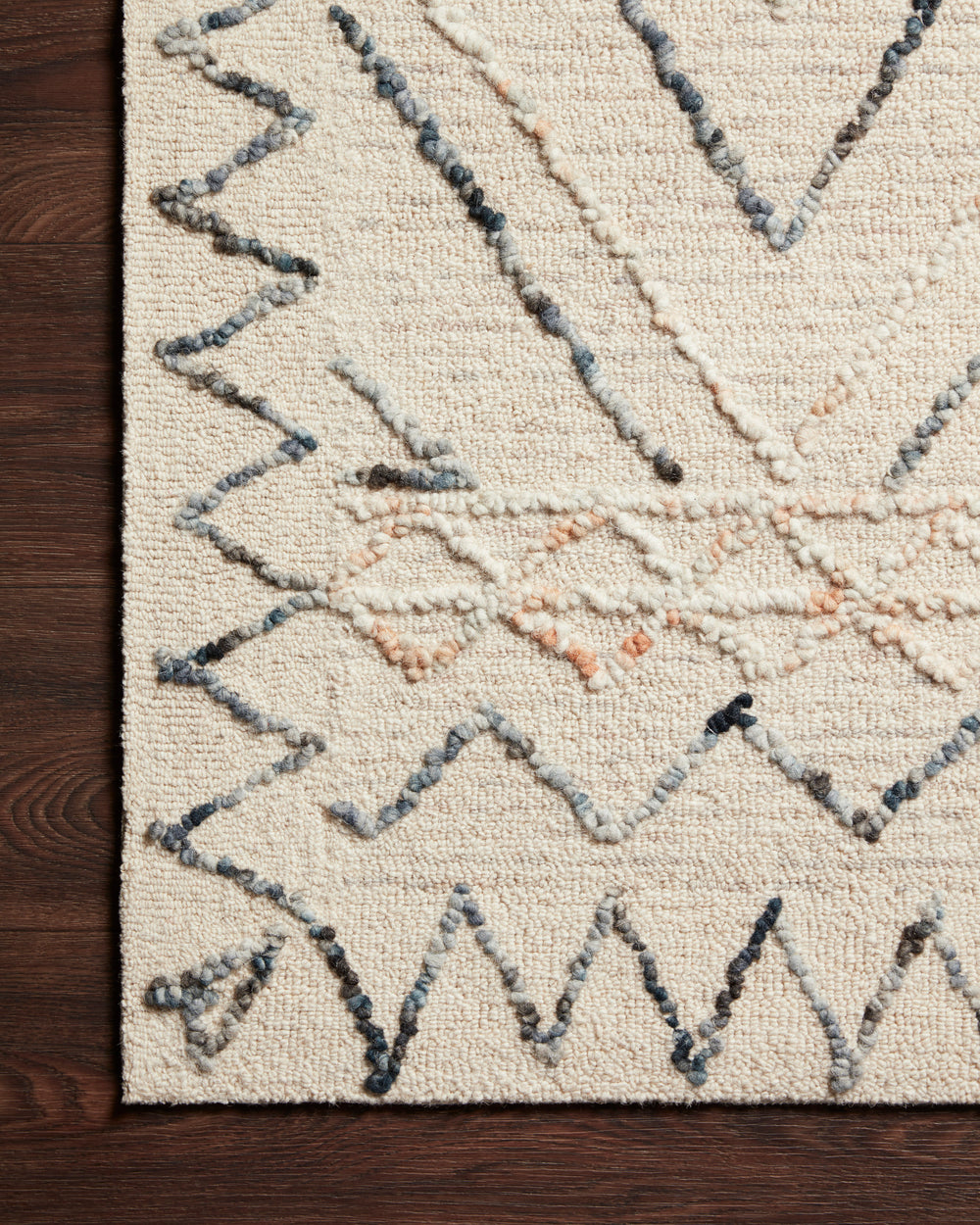 Inspired by abstract and geometric freehand art, the Leela Collection is designed by Justina Blakeney. Hooked of 100% wool pile, the designs create the illusion of visual movement.  Hand Tufted 100% Wool LEE-02 Oatmeal/Denim