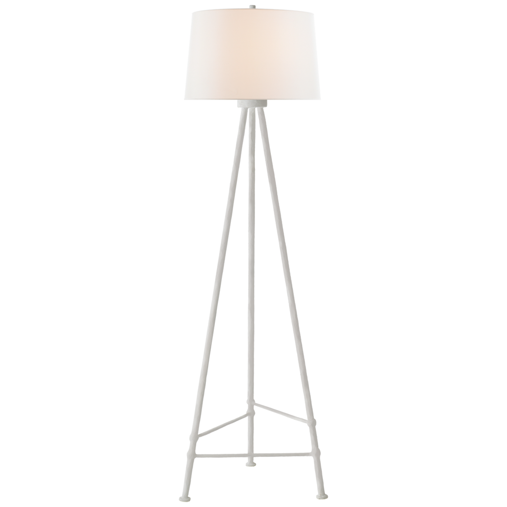 W love the thin, hammered tripod base of this Lafitte Leaf Large Floor Lamp by Visual Comfort. The linen shade brings a warm, modern look to any living room, bedroom, or other area needing extra light.   Designer: Julie Neill