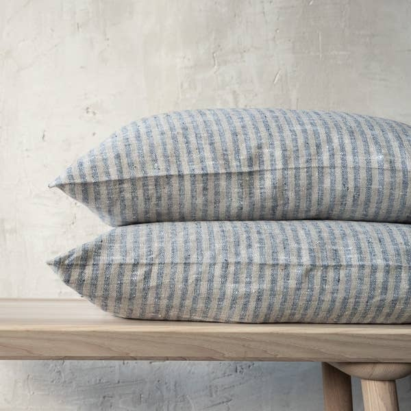 The Linen Brittany Indigo/Natural Cushion Cover from LinenMe are crafted from supersoft, comfortable yet hard-wearing linen. Featuring a hidden zipper closure and delightful fringing on two sides, they are sure to bring a beautiful, magical night of sleep.   Ships from Lithunia within 33-47 days. Some things are worth the wait!
