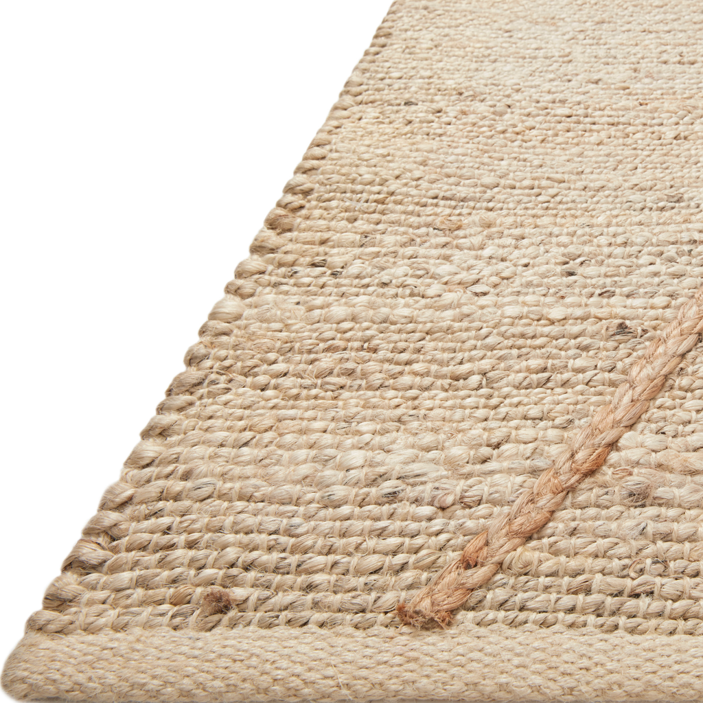 A tonal approach to Moroccan-inspired rugs, the Bodhi Ivory / Natural BOD-01 rug from Loloi is hand-woven of 100% jute. This rug features linear and braided details, creating natural variations that make a subtle yet striking statement for an entryway, living room, hallway or kitchen runner, or dining room. Amethyst Home provides interior design, new construction, custom furniture, and rugs for the Kansas City metro area.