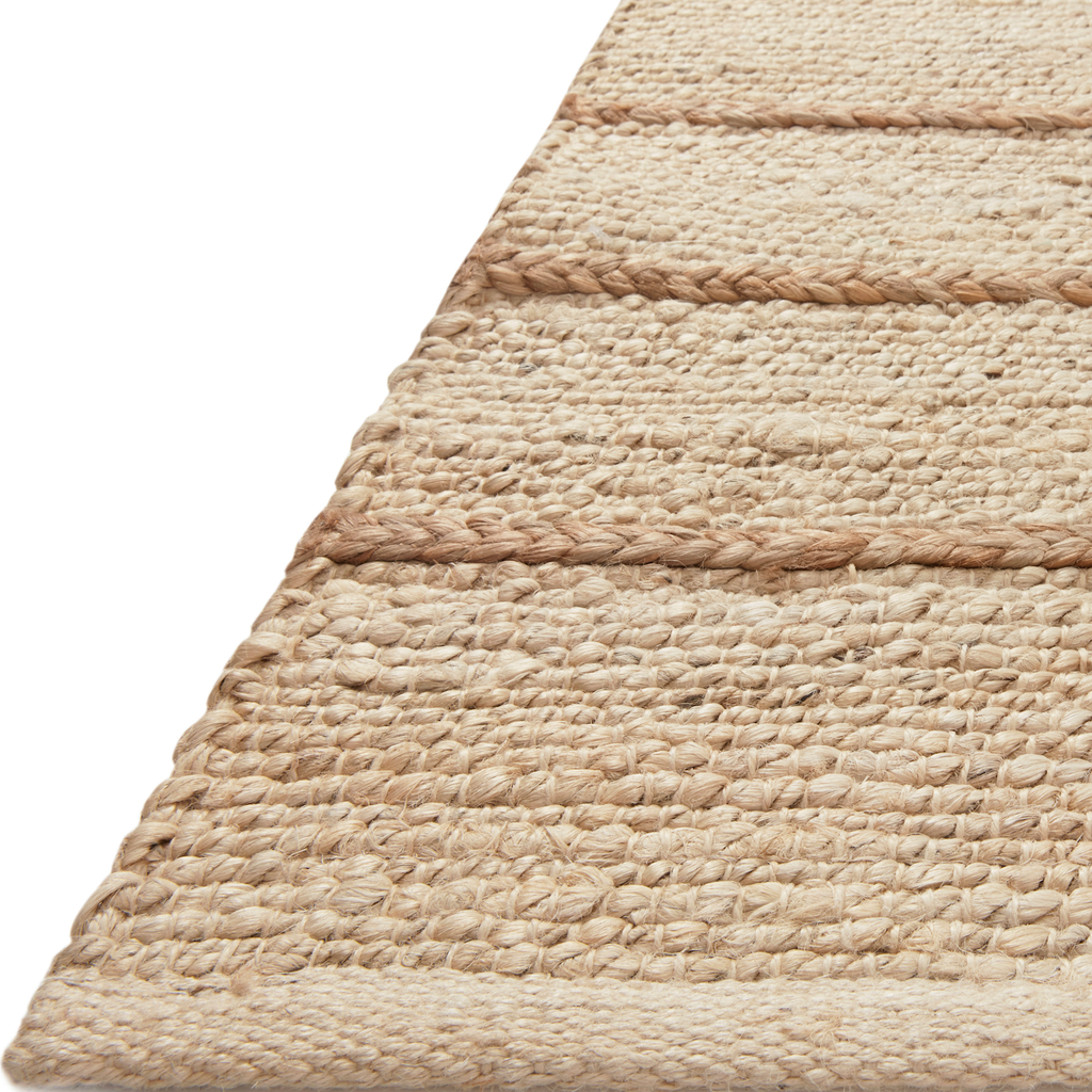 A tonal approach to Moroccan-inspired rugs, the Bodhi Ivory / Natural BOD-04 rug from Loloi is hand-woven of 100% jute. This rug features linear and braided details, creating natural variations that make a subtle yet striking statement for an entryway, living room, hallway or kitchen runner, or dining room. Amethyst Home provides interior design, new construction, custom furniture, and rugs for the Kansas City metro area.