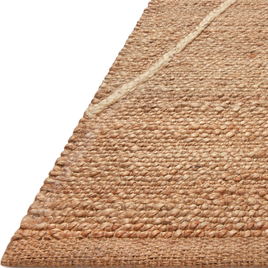 A tonal approach to Moroccan-inspired rugs, the Bodhi Natural / Ivory BOD-03 rug from Loloi is hand-woven of 100% jute. This rug features linear and braided details, creating natural variations that make a subtle yet striking statement for an entryway, living room, hallway or kitchen runner, or dining room. Amethyst Home provides interior design, new construction, custom furniture, and rugs for the Kansas City metro area.