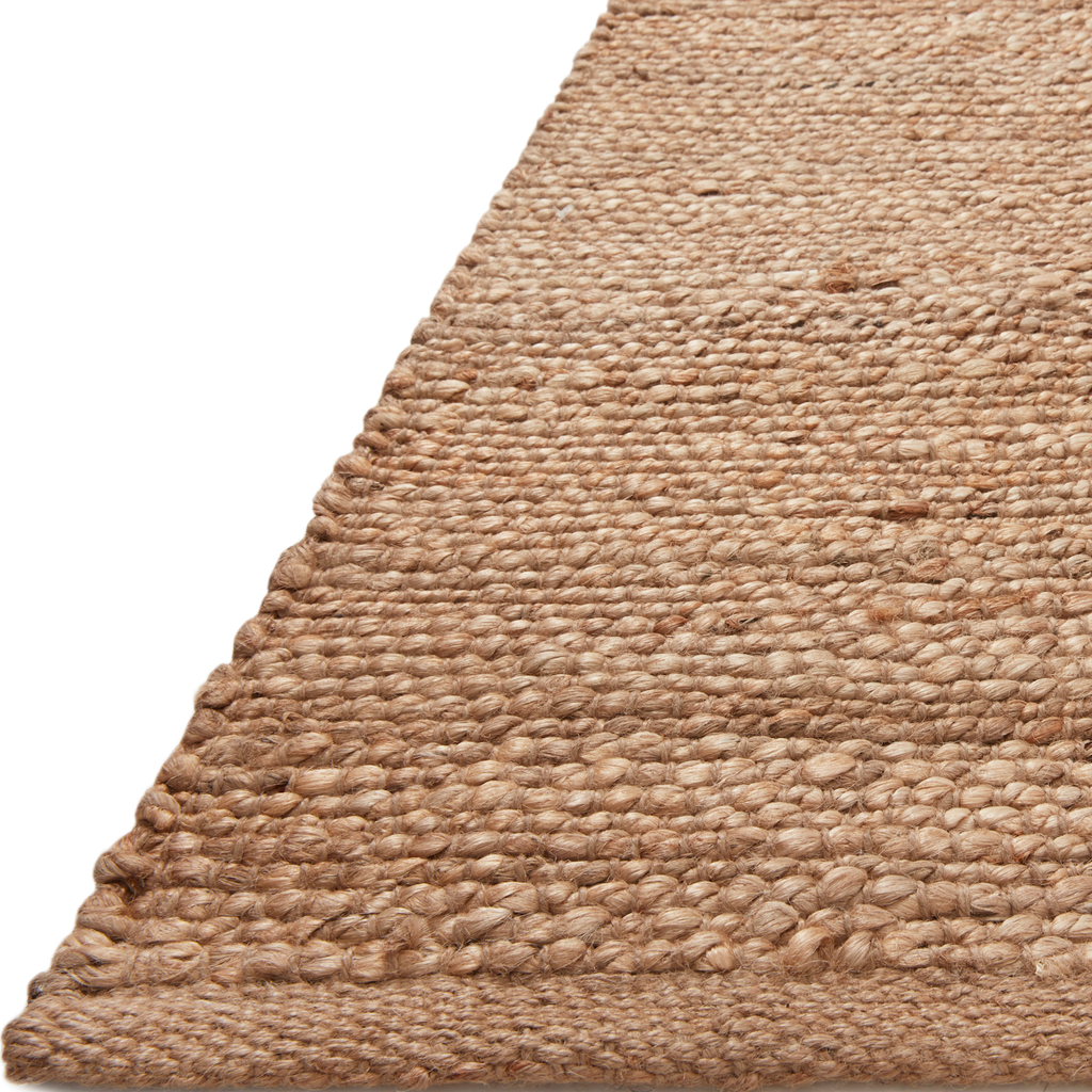 A tonal approach to Moroccan-inspired rugs, the Bodhi Natural / Natural BOD-05 rug from Loloi is hand-woven of 100% jute. This rug features linear and braided details, creating natural variations that make a subtle yet striking statement for an entryway, living room, hallway or kitchen runner, or dining room. Amethyst Home provides interior design, new construction, custom furniture, and rugs for the Kansas City metro area.