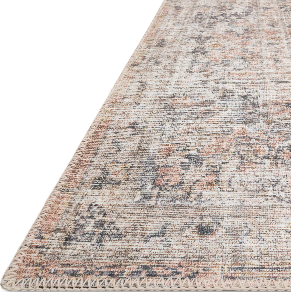 The Skye Blush/Grey SKY-01 area rug by Loloi, is timeless and classic with a beautiful, old-world design in tones of blush, grey, and ivory. Power-loomed of 100% polyester, this rug is great with families and pets. This rug is perfect for kitchens, dining rooms, entry ways, or anywhere high traffic. Amethyst Home provides interior design, new construction, custom furniture, and rugs for the Kansas City metro area.