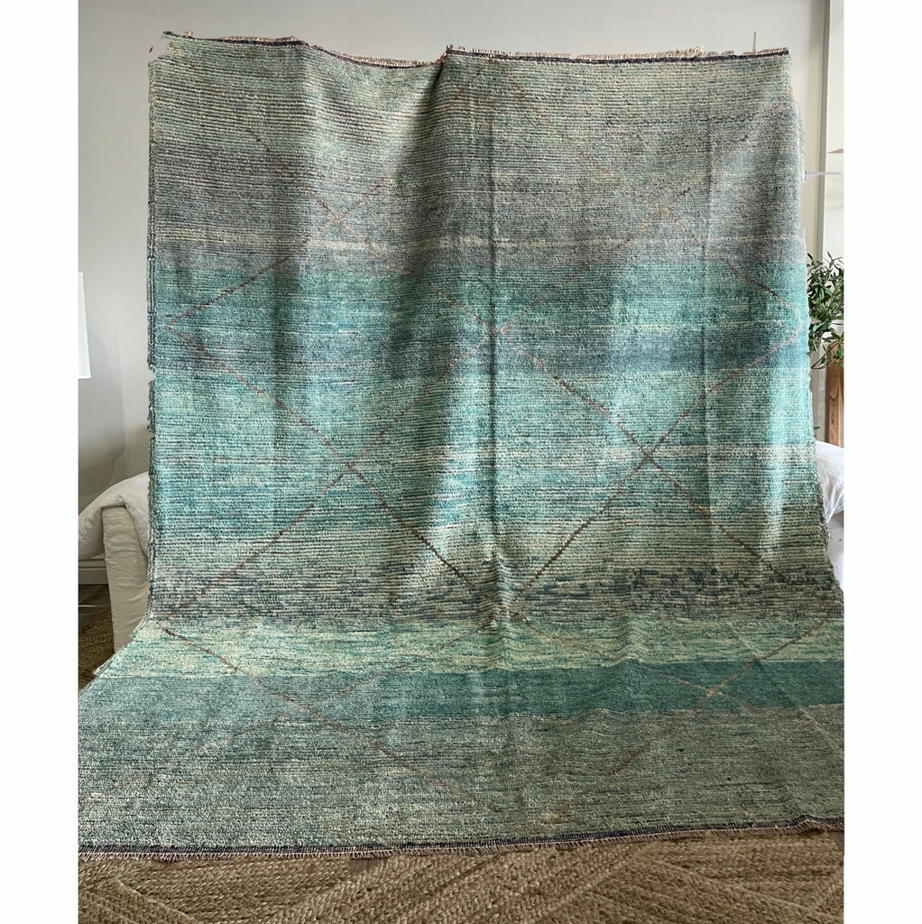 "We love the blue shades of this Lucy Limited Edition New Moroccan Style Rug. This hand knotted area rug is easy to care and maintain and will have very little shedding. The rug is a perfect fit for an entry way, living room, bedroom, or other large area!   Hand Knotted 100% Wool 8'2"" x 10'1"""