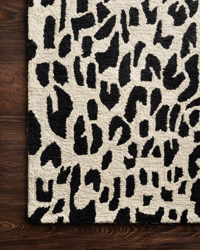 Hooked of 100% wool, this Masai Collection is a softer side of the savannah brought to life by artisans in India. Masai is a beautiful contemporary rug with contrasting hues and is a chic twist on the classic animal print.  Hooked 100% Wool MAS-02 Black / Ivory