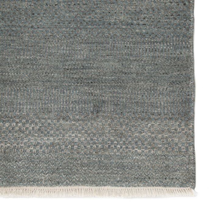 The Modica collection features finely detailed, modernized grass patterns and an exquisite hand-knotted quality. The Irminio area rug boasts luxe blend of soft viscose and natural wool for rich texture and timeless appeal. The light blue and gray colorway grounds spaces with effortless versatility.  Hand-Knotted  70% Wool | 30% Viscose MOD01 Modica Irminio Rug