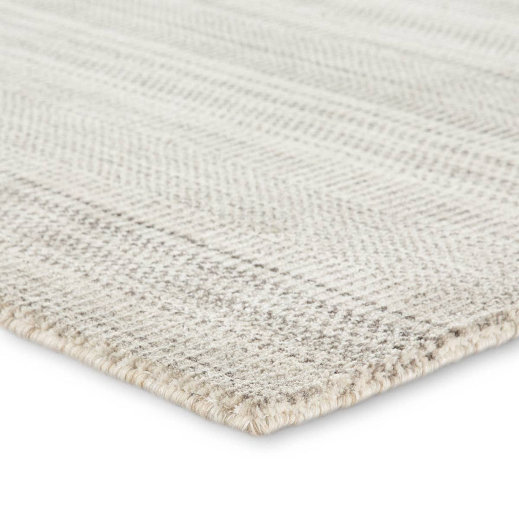 The Minuit area rug from the Trendier collection brings dimension to any room with a finely detailed pattern in variegated neutral colorway.  Soft to the touch, this hand-loomed wool and viscose accent effortlessly blends inviting texture and a timeless design. This rug is ideal for bedrooms, dining rooms, or any room you want to be more cozy and comfortable!  Hand Loomed 80% Wool | 20% Viscose TEI01