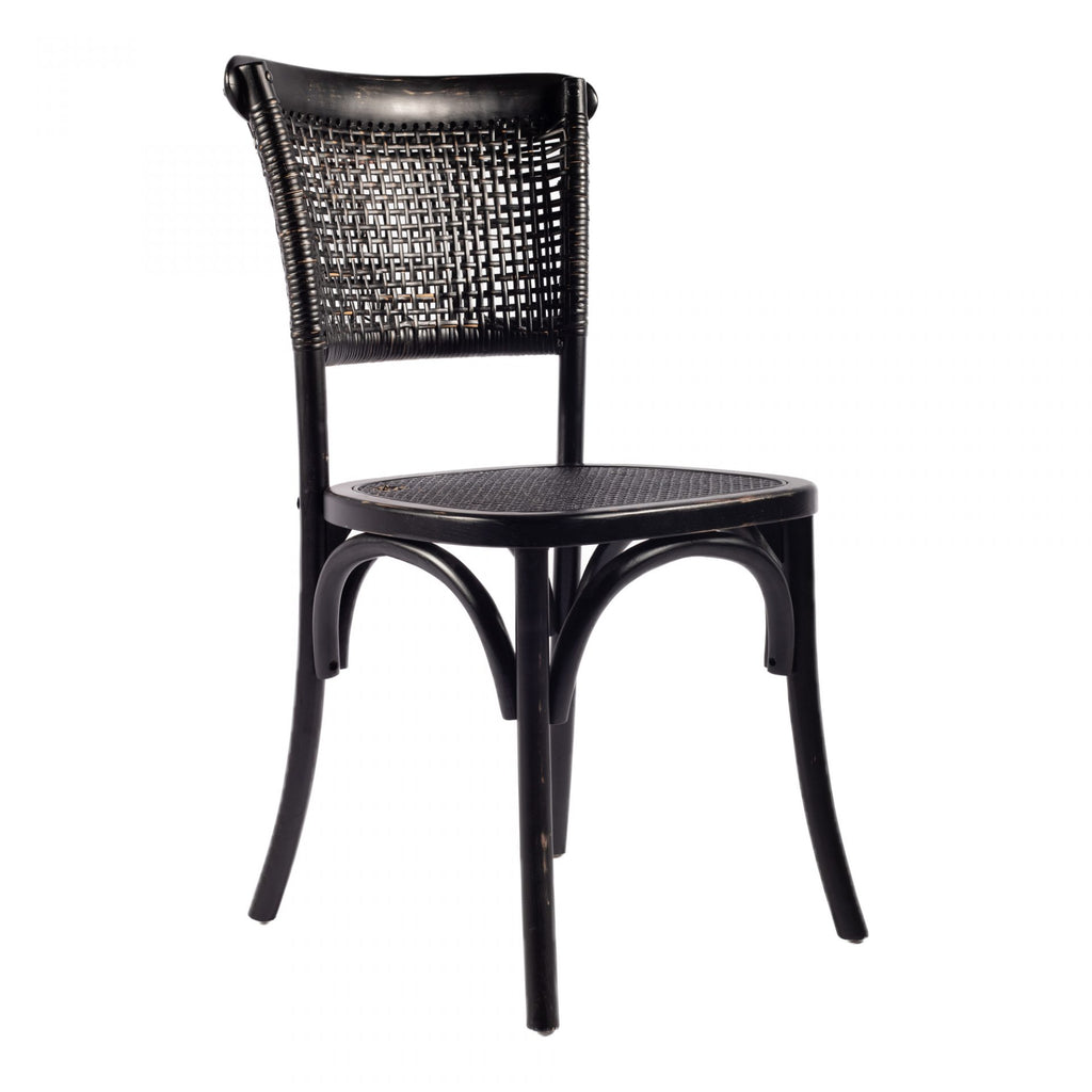 "Made of rattan and solid elm, this Churchill Black Dining Chair gives us all the vintage vibes. A perfect dining chair for those going for a boho-chic look!  Size: 18""W x 16.5""D x 34.5""H Leg Height: 17""H , Seat Depth: 16""D , Seat Width: 17""W, Seat Height: 18.11"" Materials: Solid Elm Frame, Rattan"