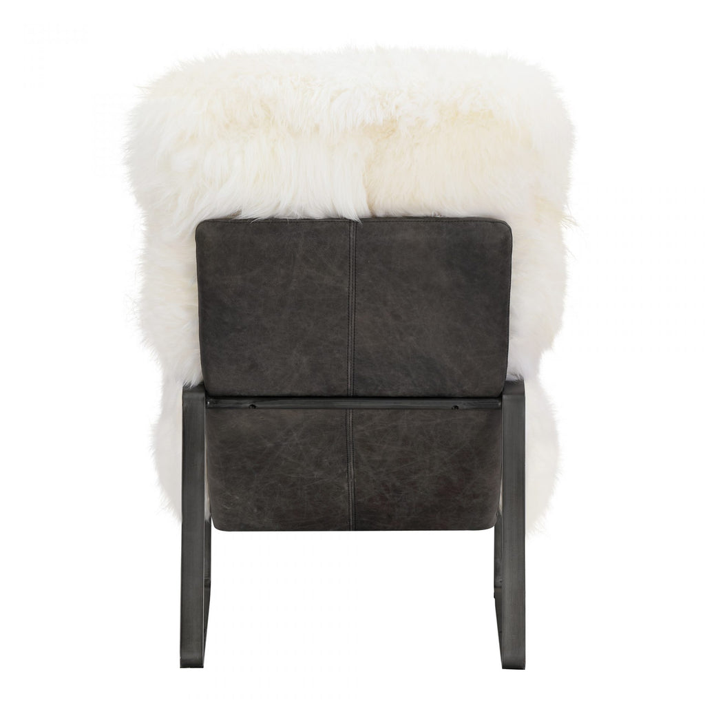 "We love the long hair sheepskin matched with the iron frame on this Hanly Accent Chair. This is a stunning and comfy chair to add to any living room or office space.   Size: 25""W x 37""D x 37""H Seat Height: 17.5"" Back Height: 26"" Arm Height: 4""  Materials : Long Hair Sheepskin Upholstery, Foam and Feather Fill, Iron Fram, Top Grain Leather"