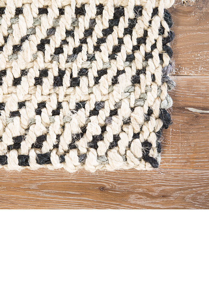 The Almand area rug from the Naturals Tobago collection features a fresh take on a classic natural accent. This hand-loomed jute layer showcases a unique mottled effect in a duo-tone colorway of white and black. Organic and casually sophisticated, this contemporary foundation offers eco-friendly, on-trend style.  Naturals Construction 100% Jute NAT26