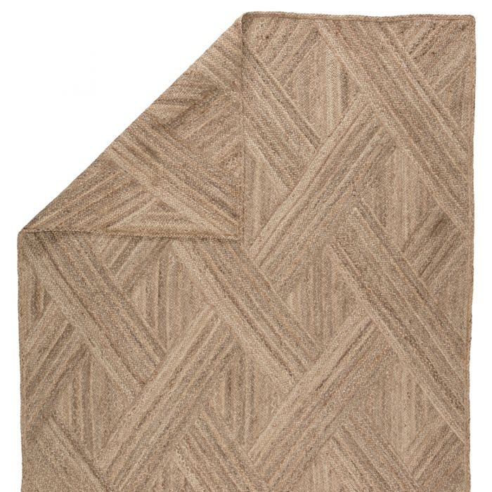The Naturals Tobago Vero rug from Jaipur Living delivers rich texture and organic allure to contemporary homes. The Vero area rug showcases a distinctive diagonal weave design, hand woven of jute. The warm colors of honey and tan of this stunning natural jute rug lends a grounding, boho vibe to any space as either a runner or area rug.