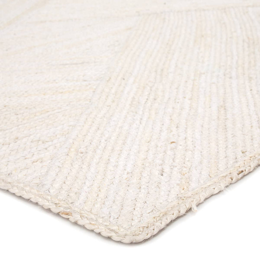 The Naturals Tobago collection delivers rich texture and organic allure to contemporary homes. The Vero area rug showcases a distinctive diagonal weave design, hand woven of bleached jute fibers. The white colorway of this stunning natural lends a chic, contemporary vibe to any space.  Naturals Construction 100% Jute NAT35