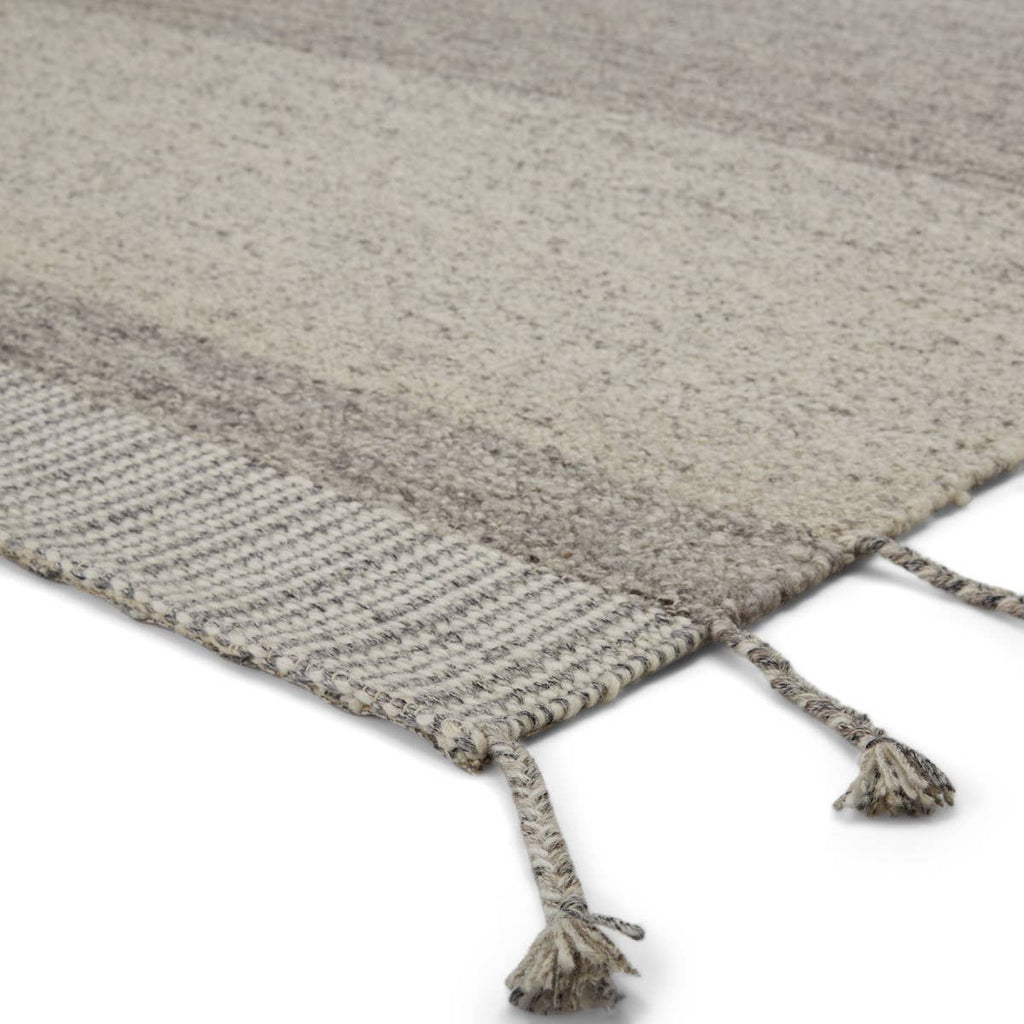 The Nazca Coolidge Area Rug by Jaipur, or NAZ02, is hand-loomed of texture-rich wool. The Coolidge area rug boasts a tonal gray colorway that lends versatility to the simple yet statement-making linear motif. This is a perfect rug for a living room, bedroom, or other high-traffic areas.