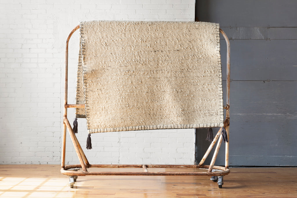 Expertly hand-woven in India of wool and polyester, the Oakdell OAK-01 ED Natural offers a series of understated neutrals in a timeless flatweave construction. The naturally multicolored yarn is accented by loop edge stitching and corner tassels. Crafted by Loloi for ED Ellen DeGeneres.