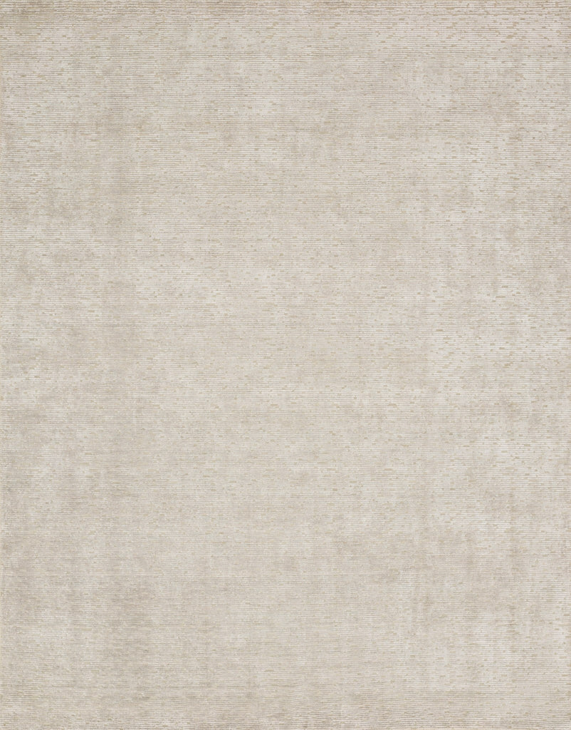 Ollie Beige Rug - Amethyst Home Hand-loomed in India of viscose and wool, the Ollie Collection offers a series of understated neutrals complemented by a feel-good texture. Available in sizes up to 9'6'' x 13'6.