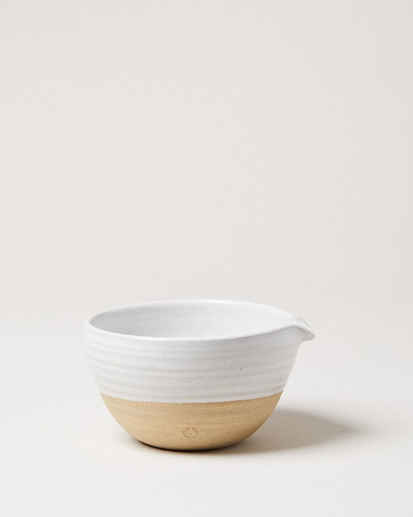 "Handmade in Vermont by Farmhouse Pottery, this Pantry XL Bowl is both beautiful and useful. We love how the easy pour spot makes cooking and baking a breeze.   Size: 12"" x 6""  Oven, microwave, and dishwasher safe"