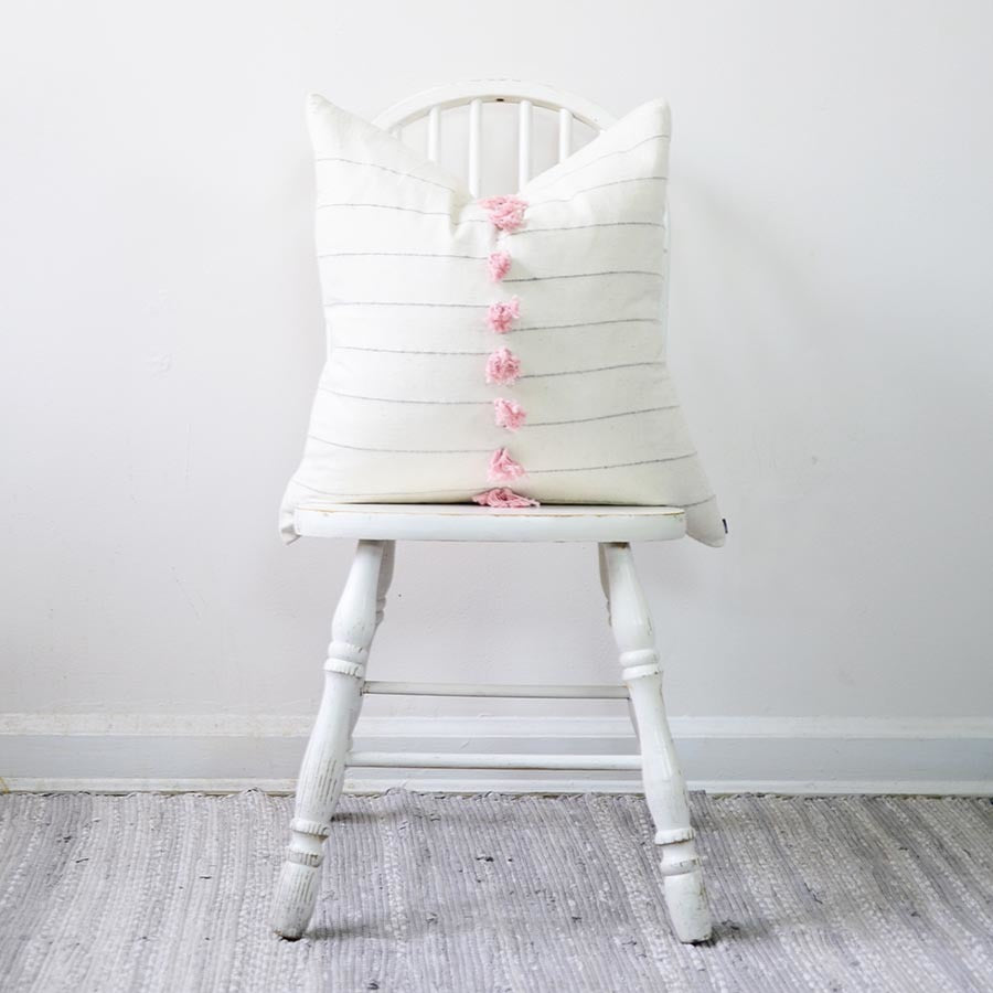 This pink, white and grey textured pillow is great fun. It's what we call hygge-bohemian because it's minimalist yet has subtle colors! The fabric is made from organic cotton that is hand spun and woven by artisan weavers on the handloom.