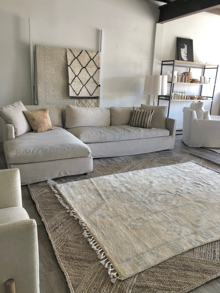 "We love the tassels and muted, blue medallion designs on this Porto New Moroccan Modern Area Rug. This hand knotted vintage area rug is easy to care and maintain and will have very little shedding. A gorgeous area rug to add to any living room, entryway, or bedroom.   Hand Knotted 100% Wool 5'7"" x 8'0"""