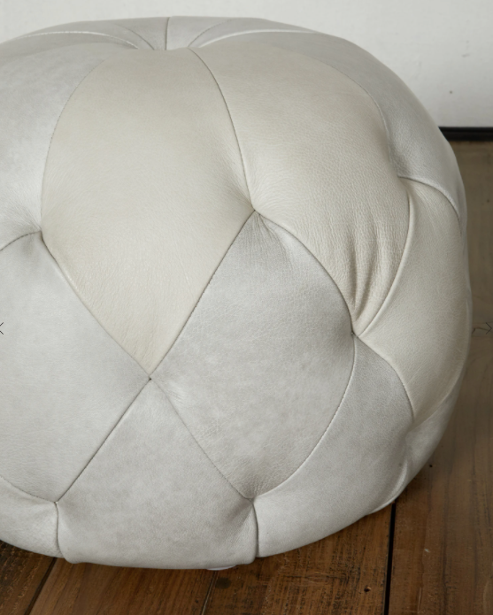 "We love the stitching detail on this Pouf 20"" Ottoman by Cisco Brothers. Place in your den, living room, or other entertainment area of your home and keep for years to come! Photographed in Anvil Stone.   Overall: 20""dia x 15""h Seat Height: 15""h"