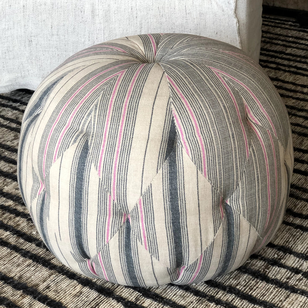 Simply gorgeous, the Pouf from Cisco Brothers is unmistakeable. Each hand-crafted pouf is expertly crafted by artisans with the signature diamond tufted seat. Metal glides provide support as the legs for a sturdy base. The 100% linen fabric on this floor sample pouf is discontinued making this truly one-of-a-kind! As this is a floor sample, this is a final sale with no returns/exchanges.