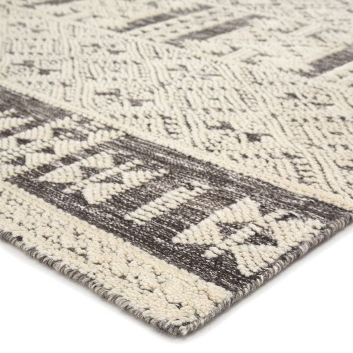 The captivating Reign collection introduces detail-rich design and inviting high-low pile to contemporary and traditional homes alike. The hand-knotted Origins rug boasts an intricate geometric design in a neutral ivory and brown colorway. This wool rug's raised pattern grounds spaces with striking depth and dimension.  Hand-Knotted 100% Wool REI06 Reign Origins
