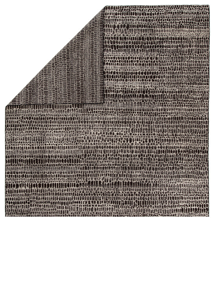 The Reverb collection by Pollack features pattern-rich styles with a globally modern touch. The grid-like geometric design of the hand-knotted Kinetic area rug offers a dynamic look to any space. Crafted of 100% wool, this durable, artisan-made rug is a bold addition to rooms with a contrasting black and ivory colorway.  Hand-Knotted 100% Wool REP01
