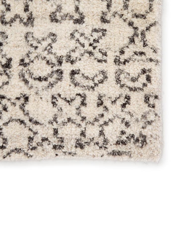 The Reverb collection by Pollack features pattern-rich styles with a globally modern touch. With a whimsical grid-like design of askew geometric shapes, the hand-knotted Reverb area rug offers a dynamic look to any space. Crafted of 100% wool, this durable, artisan-made rug is a bold addition to rooms with a contrasting black on ivory colorway.  Hand-Knotted 100% Wool REP02