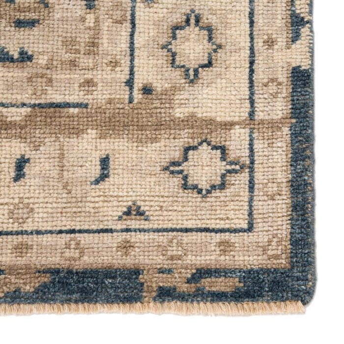 The Rhapsody collection features heirloom-quality designs of stunningly abrashed Old World patterns. The Cadenza area rug showcases a distressed center medallion in natural taupe and deep blue hues. This durable wool hand knot anchors living spaces with traditional style.  Hand-Knotted 70% Wool | 30% Viscose RHA01 Rhapsody Cadenza Rug