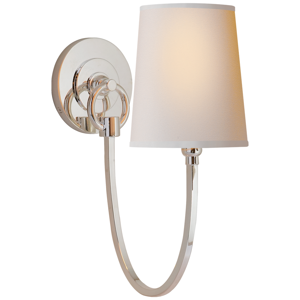The Reed Single Sconce has a natural paper shade that brings exudes warmth. This would look gorgeous in a hallway, bathroom, or another area needing extra light  Designer: Thomas O'Brien