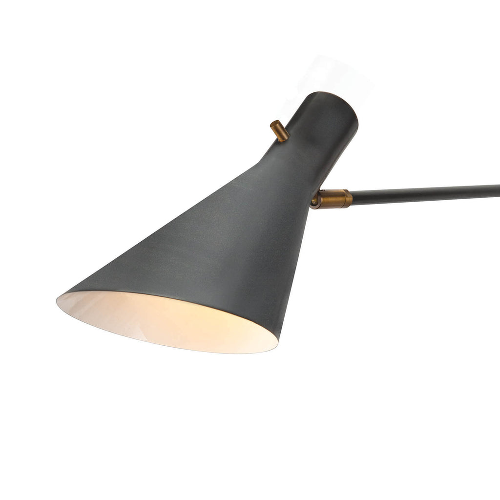 "We love that this Spyder Sconce has two adjustable arms with a uniquely shaped shade. Finished in either black or white, this provides a modern look to any office, living room, or other area needing some artificial lighting.  Overall size: 5.75""w x 53.5""d x 20""h"