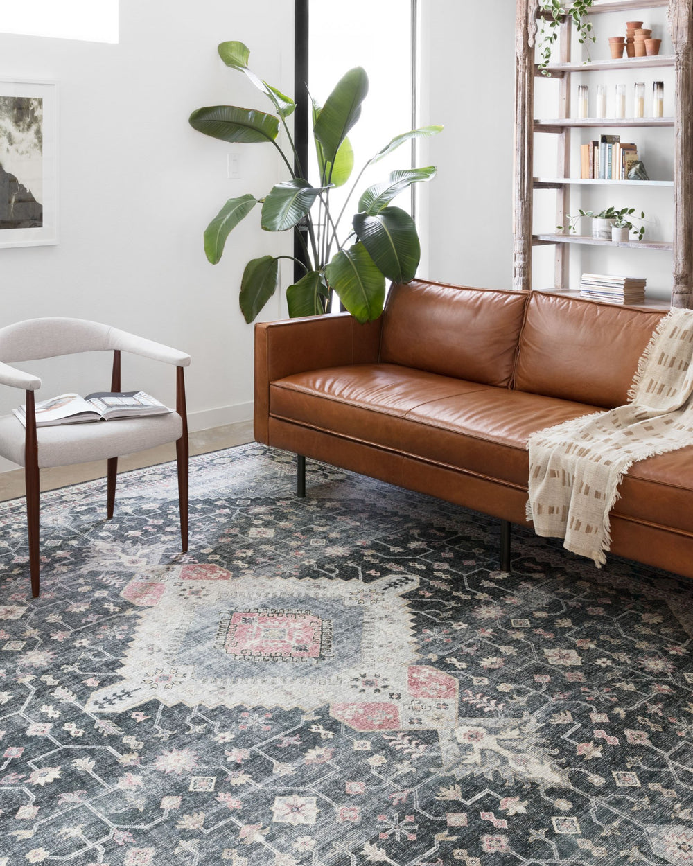 The Skye Collection is timeless and classic with a beautiful, old-world design in a variety of color choices. Power-loomed in China of 100% polyester, these printed designs provide the textured effect of high-end rugs at an affordable price.  Power Loomed 100% Polyester SKY-02 Charcoal/Multi