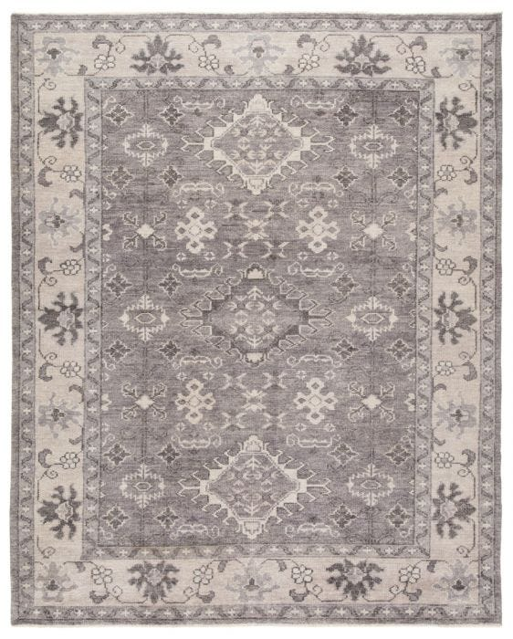 The Salinas collection is punctuated by traditional, intricate details and a soft, hand-knotted wool construction. The neutral Kella area rug makes a transitional statement with grounding hues and tribal motifs. This durable, artisan-made rug features a floral border and medallion accents in a tonal gray colorway.  Hand-Knotted 100% Wool SLN12 Salinas Kella