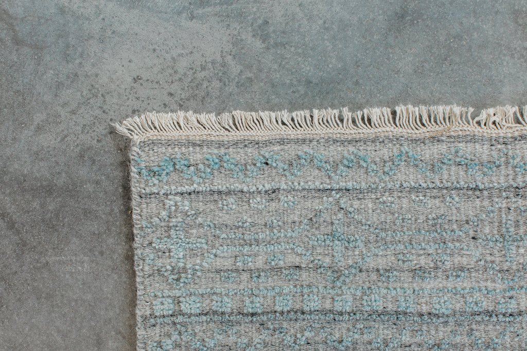 Both timeless and modern, the Idris Spa area rug from Loloi is meticulously hand-knotted in colors of blue, grey, and ivory. The tonal series features an elevated texture, accentuating the detailed pattern. The Idris Spa rug, also known as ID-03 Spa, is hand-knotted of 70% Viscose and 30% Wool.