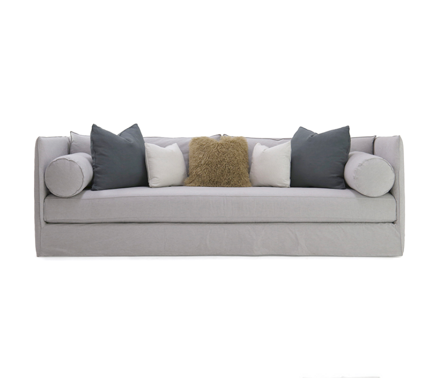 The Andrea Sofa Family is bench-crafted with a sustainably harvested hardwood frame and 8-way hand-tied seat construction. Standard features include:  • spring down seat construction • boxed style back and seat cushion • double needle stitch detail • notch bottom toss pillows • bolster style arm pillow • upholstered and slipcovered available