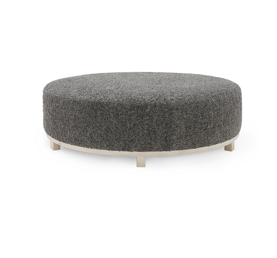 The Elliot Ottoman is bench-crafted with a sustainably harvested hardwood frame in our North Carolina atelier. It comes standard with: • Foam and Fiber Seat Construction • Double Needle • Fabric Covered Ball Button on Top • Please Specify Base Finish • Available Upholstered Base • Upholstered Only