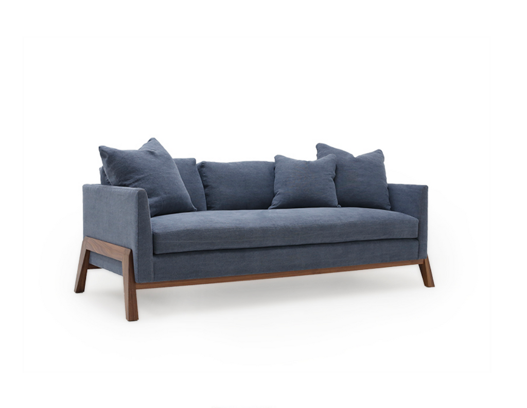 The Verellen Finn Sofa Family combines a hand-sculpted exposed wood frame with our beautiful upholstery for one-of-a-kind style. Standard features includes:  Foam down seat construction 5″ boxed back pillows Knife edge toss pillows Double needle stitch detail Upholstered Walnut or ash base