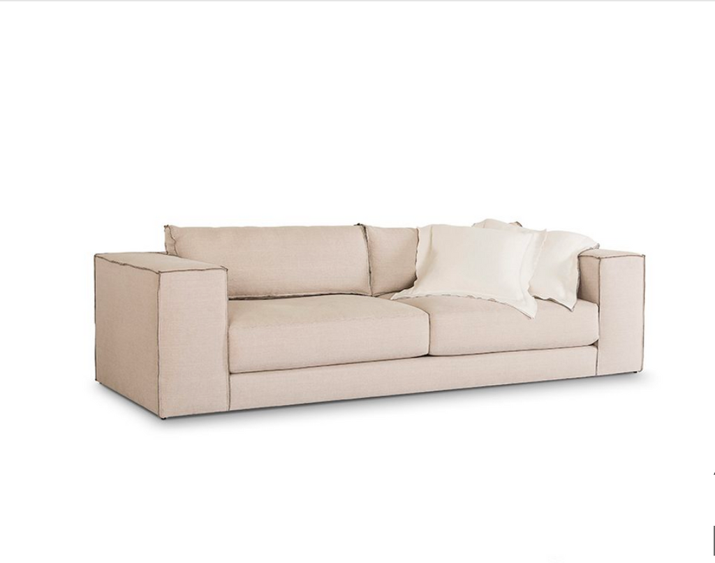 Bring pure and simple style to any environment with the Manuel Sofa. Bench-crafted in Verellen's North Carolina atelier, it features:  spring/down seat construction boxed style bench seat cushion bullnose back pillow with inside-out stitch detail 3″ open flange toss pillows double needle stitch detail on glides only