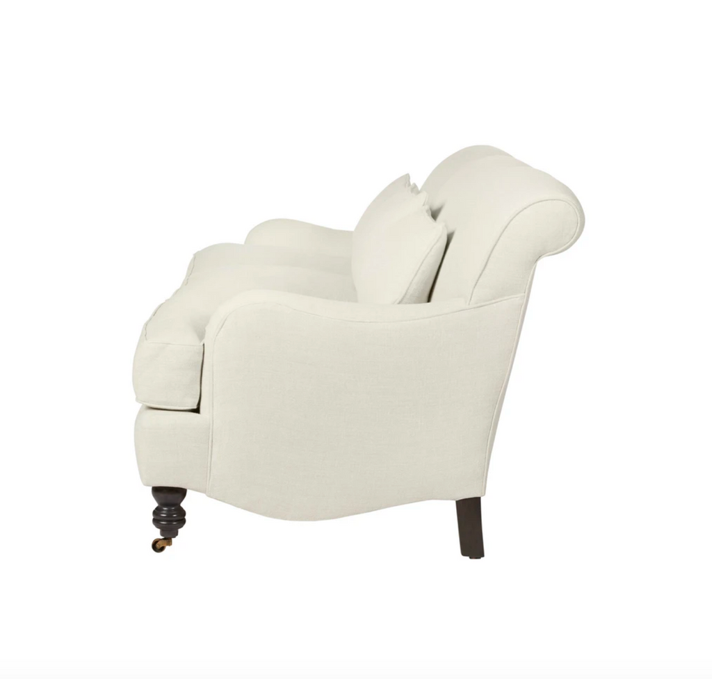 The Beaumont Sofa by Cisco Brothers is a twist on traditional style, with a piping detail and turned front legs with antique casters. Relax into the comfortable lumber pillows for back support with style.  Priced and pictured in grade K fabric Brevard Birch.