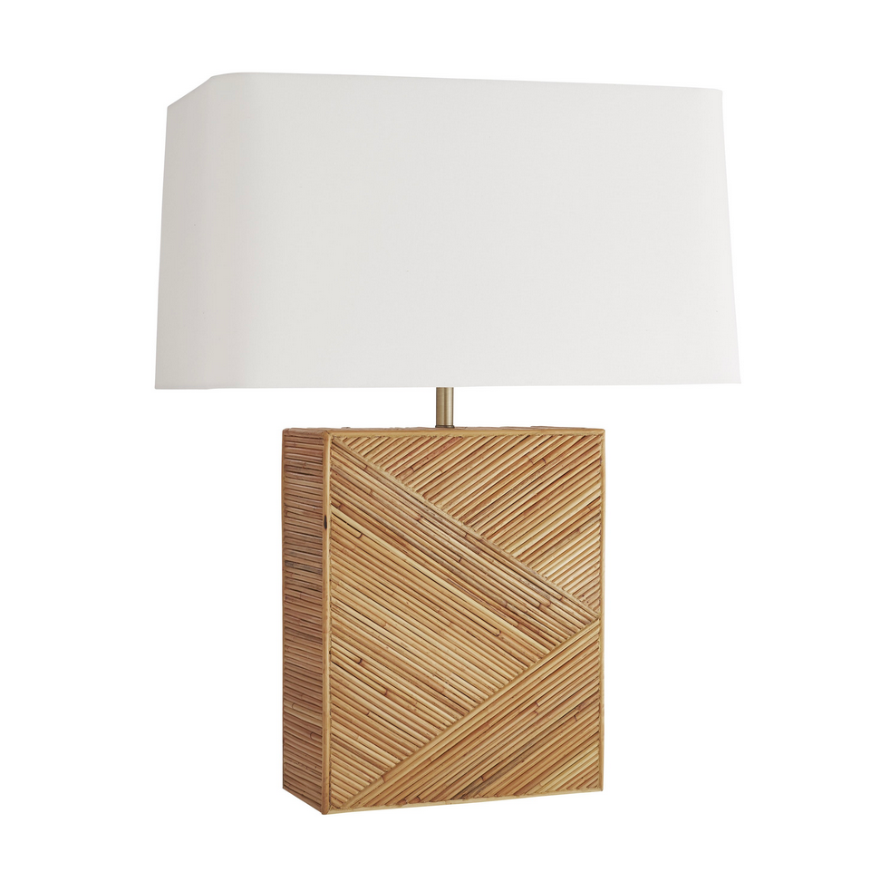 "This Domingo Lamp is crafted of rattan in its natural form, varying tones that artistically enhance the organic textures. Topped with an off-white linen rectangular shade with white cotton lining and a matching rattan finial, we'd love to see this in a bedroom or living room. Finish may vary.  Size: 29""h x 22""w x 13""d"