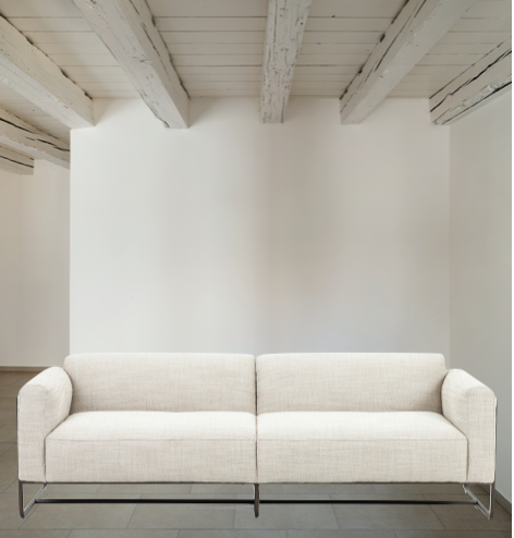 "Neutral gone novel with this Ella Gable Taupe 91"" Sofa. Taupe-colored upholstered seating is suspended by top-grain leather straps with handcrafted fastens, for an airy look. Solid rubberwood paneling wraps the frame's entirety, while a black iron base lends lightness and contrast."