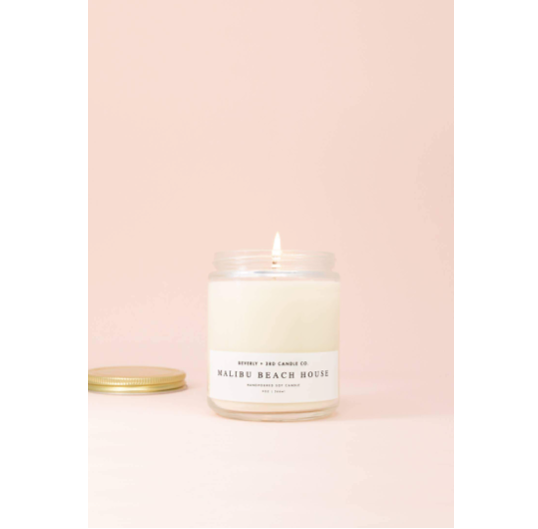 The Malibu Beach House Wood Wick Candle is made in Illinois, US with 100% grown soy wax. We how it reminds us of warm, sunny days laying by the ocean - feet in the sand.   Size: 9oz  Phtalate-free. 70+ hour burn time.