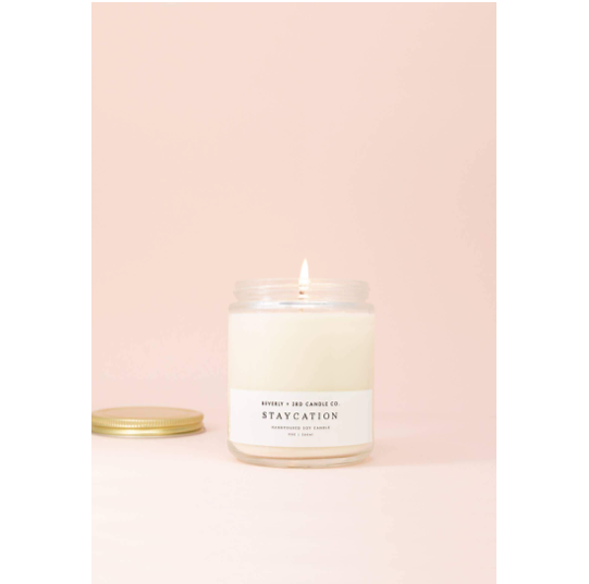 This handcrafted Staycation Wood Wick Candle is the perfect blend of orange, eucalyptus, patchouli and ylang ylang.   Size: 9oz  Phtalate-free. 70+ hour burn time.