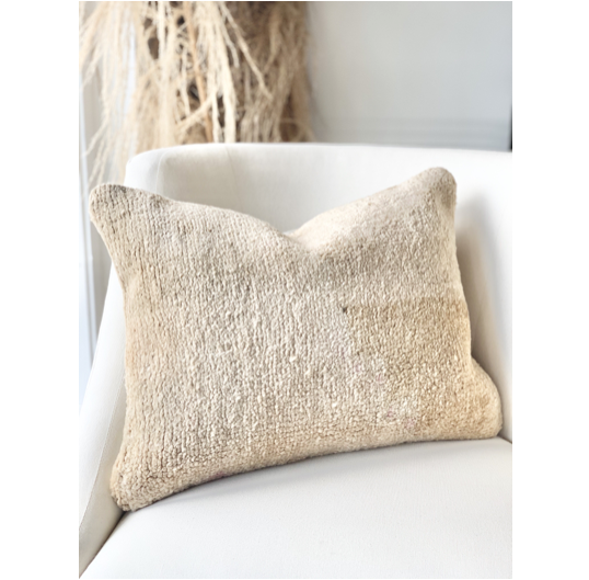 "Vintage one-of-a-kind pillow, and exclusive to Amethyst Home. 100% Wool with cotton backing. Down-filled insert included.  Size: 20""x15"""