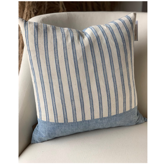 "This organic cotton pillow is hand spun and woven by hand on a handloom and then stitched into this beautiful pillow. Reversible pillow cover, either go stripe, or sky blue, depending on your mood. Hidden zipper, keeps the look clean and sophisticated for your next get together.  Down feather pillow insert included.  Hand/machine wash pillow cover seperately on cold, gentle cycle. Dry flat. Iron if necessary.  Size: 16"" x 16"""
