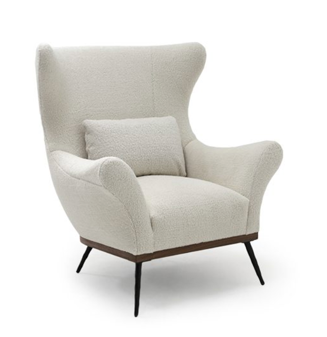 "A timeless Verellen classic -- the Paola chair is the perfect hug. Upholstered in a poodle like fabric with walnut base and hand-hammered iron legs, its sophistication and uniqueness makes it unforgettable.  • Overall Width: 42"" • Overall Depth: 36.5"" • Overall Height: 46"" • Seat Height: 21"" • Arm Height: 27.5"" • Seat Depth: 16"" • Inside Seat Depth: 23.5"""