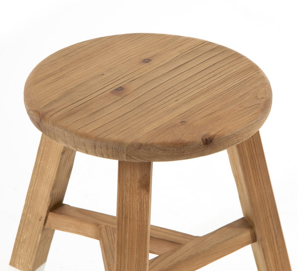 The Hattie White Dip Round Accent Stool is crafted from natural reclaimed pine that's been white-dipped for fresh contrast. Smartly sized for the bathroom, bedroom or small entryway, alone or in multiples.