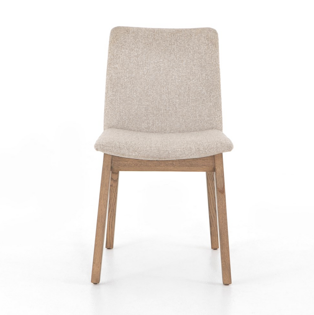 The Zane Dining Chairs may be small in scale, but are big on style. The chair comes in two tones with square-tapered beech wood legs to support sleek, armless seating for a modern-minded take on everyday dining. Posterior framing features a hidden, hand-carved handle for a detail-driven finishing touch.