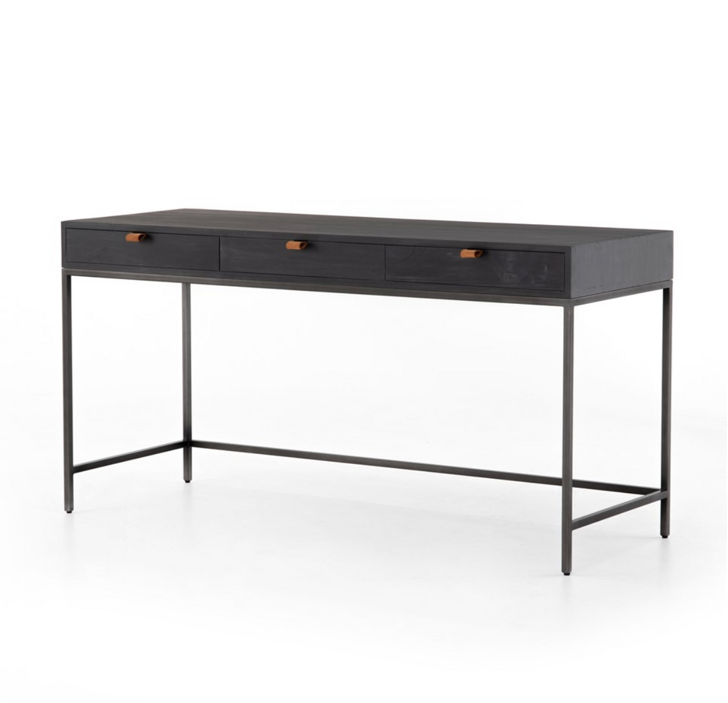 The Trey Black Wash Poplar Modular Writing Desk sleek and simple, black-finished poplar offers plenty of desk storage by way of three spacious drawers. Metal-secured pulls of top-grain leather add a textural element of surprise. Great solo or paired with matching corner desk, file cabinet or credenza.